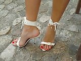 10 New white high heel sandals and ring on big toe.