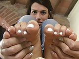 Teen feet in socks with white nail polish