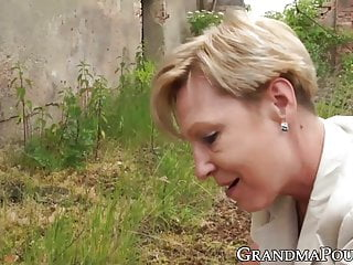 Outdoor Granny Dildo video: Naughty granny pegging her young fucker after being fucked