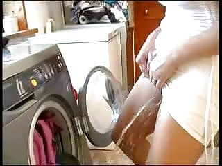 Mature Pissing video: She pees in the washing machine