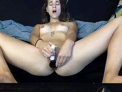Teen works her pussy with varied size dildos