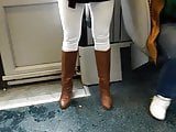 black teen in skinny white jeans and brown high heels boots
