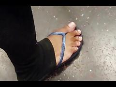 Candid ebony feet in leggings and sandals