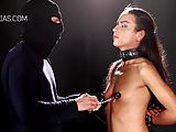 Domina whips her redhead slave