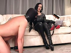Femdomlady Leather Dress and Boot Cleaning Slave