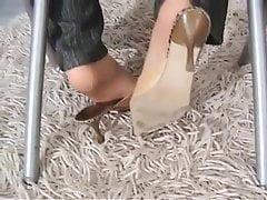 footjob under table