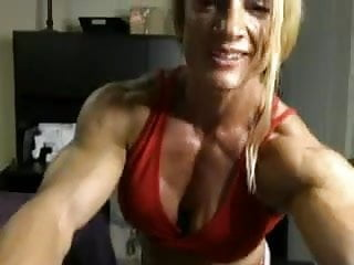 blond muscular woman shows her nude body
