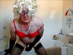 sissy ken rides his dildo in bathroom in chastity again