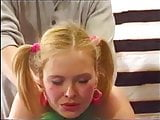 Sexy blonde teen with pigtails seduced by the photographer