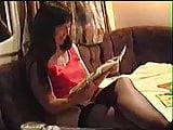 Linda reads a porno comic on holiday