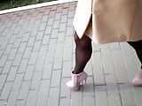 Fast walking on high heels on the paving slab