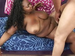 Sexy brunette BBW shows her shaved pussy to the camera