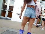 Candid voyeur latina in booty shorts with socks cheeks