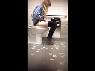 Hidden Cams Voyeur Pissing vid: Cute college teen bathroom spy cam (1 of 7)