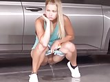 Hot girl takes a pee in the car lot