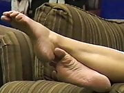Candid mature shoeplay in bookstore