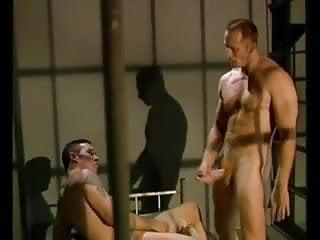 .Behind bars.