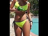 Sexy brunette babe in bikini pooring beer on herself