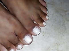 Closeup on Morenafeet's fingers with French nail polish 4