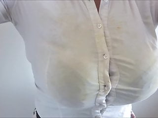 Under a tight white blouse...
