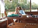 Cute Nurses Lucy and Sindy make out on a Boat