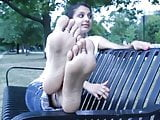 Indian Girl Relaxing on Park Bench