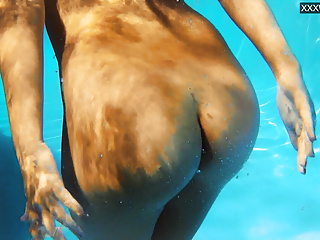 Jacqueline Hope enjoys being naked in the pool