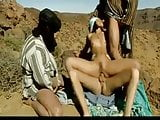 Three Arabs fucks hot Arabian  slut in desert .