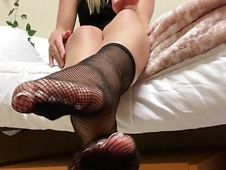 Solo girl shows off her stocking feet and toes