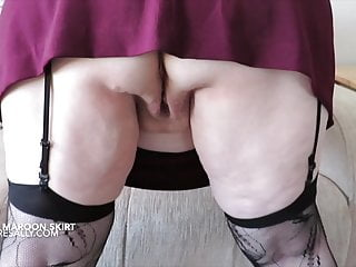 Short maroon skirt and no knickers...