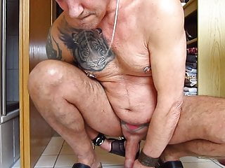 He pushes a 100 cm long dildo completely...