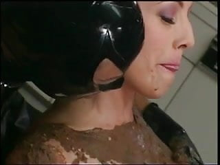 Threesome involving a chocolate covered hottie, Latex chick and a hard cock