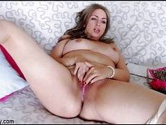 A titty Russian with red nails fingers her clit