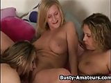 Busty amateurs on threesome in bed