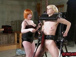 Chubby lesbian spanks and dildos the pussy of...