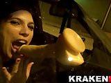 Naughty girl in public scene sucking a dildo in the car