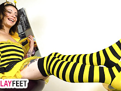 Cosplayer teases wearing striped stockings as a sexy bee