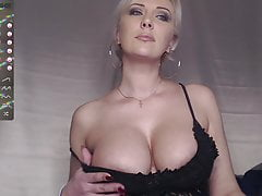 Woman with amazing breasts shows herself