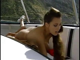 Two Red Swimsuit Babes Fuck on a Boat BV
