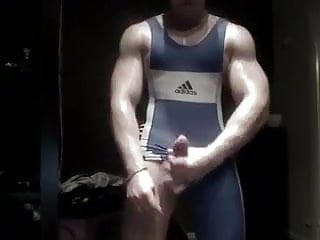 Muscled wrestler stroking singlet...