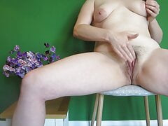 Hot woman wanks on a chair (part 1)