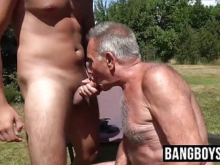 Old gay man lets his mouth be filled...