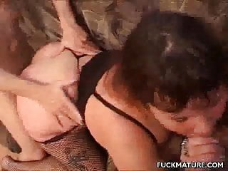 Sandwiched mature in a threesome...