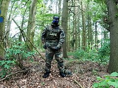 Soldier pup pawing off in the woods