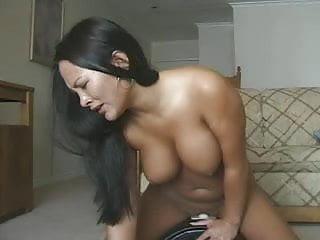 asian woman riding a sybian