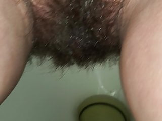 Small lover with furry vagina making an attempt to pee