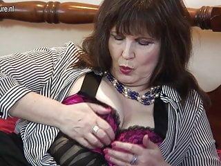 Classy granny rubs her cunt...