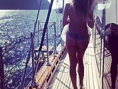 Heidi Klum on a boat from behind
