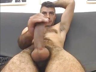 Dude massaging his tasty sausa...