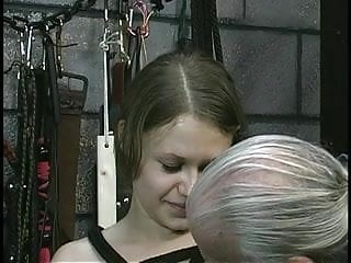 Chick in bondage gets teased by old guy